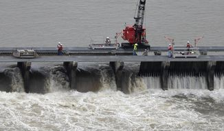 The Bonnet Carre Spillway has been open for nearly 100 days to divert rising water from the Mississippi River to Lake Pontchartrain, upriver from New Orleans. (Associated Press/File)