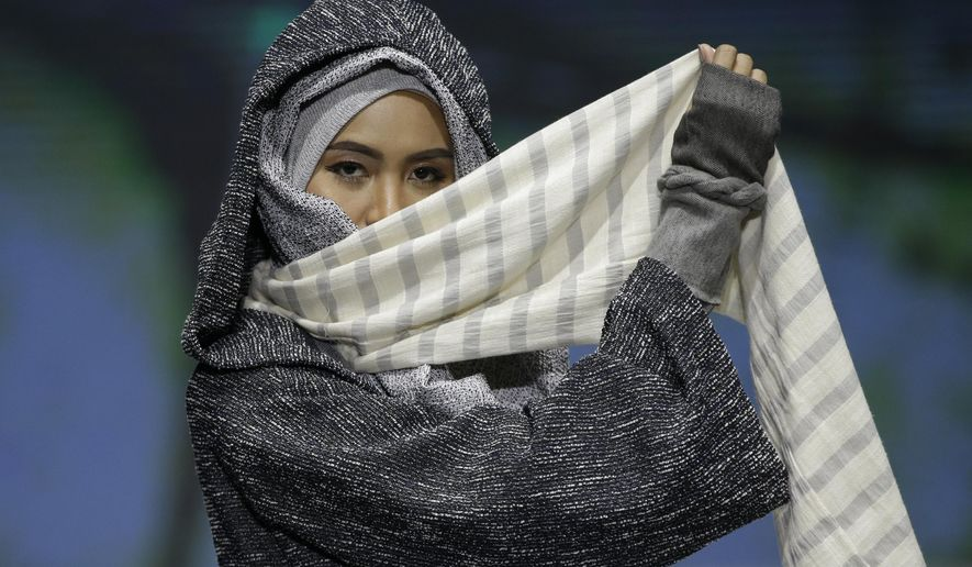 A model displays a creation by Rosie Rahmadi during the Muslim Fashion Festival in Jakarta, Indonesia, May 3, 2019. The event was held to greet the upcoming holy fasting month of Ramadan. (AP Photo/Achmad Ibrahim)  ** FILE **
