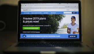 FILE - In this Oct. 31, 2018, file photo, the HealthCare.gov website is photographed in Washington. The Trump administration is arguing in court that the entire Affordable Care Act should be struck down as unconstitutional. But at the same time Justice Department lawyers have suggested that federal judges could salvage an important part _ its anti-fraud provisions. (AP Photo/Pablo Martinez Monsivais, File)