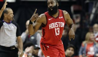 Houston Rockets' James Harden (13) celebrates sinking a basket during the first half in Game 6 of a second-round NBA basketball playoff series against the Golden State Warriors on Friday, May 10, 2019, in Houston. (AP Photo/Eric Gay)