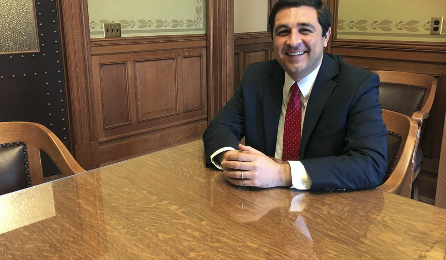 In this Thursday, May 9, 2019 photo, Josh Kaul, Wisconsin's new Democratic attorney general, sits in his Capitol office conference room in Madison, Wis. During his four months in office, Kaul has shifted the state Justice Department away from his Republican predecessor's conservative stances by withdrawing from or changing positions in a host of lawsuits. (AP Photo/Todd Richmond)