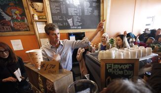In this March 15, 2019, file photo, Democratic presidential candidate former Texas congressman Beto O'Rourke greets audience members during a stop at the Central Park Coffee Company in Mount Pleasant, Iowa. (AP Photo/Charlie Neibergall, File)
