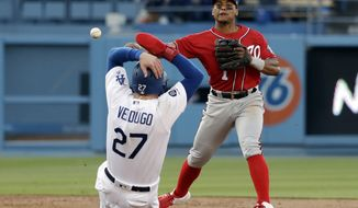 Washington Nationals shortstop Wilmer Difo, top, completes a double play over Los Angeles Dodgers' Alex Verdugo (27) on ground ball from Enrique Hernandez during the second inning of a baseball game Saturday, May 11, 2019, in Los Angeles. (AP Photo/Marcio Jose Sanchez) ** FILE **