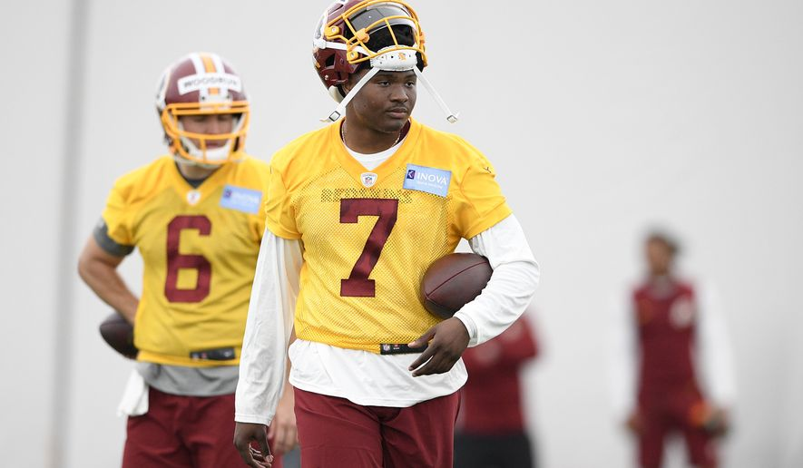 Washington Redskins quarterback Dwayne Haskins (7) stands on the field during an NFL football rookie camp, Saturday, May 11, 2019, in Ashburn, Va. (AP Photo/Nick Wass)