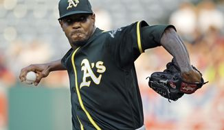 FILE - In this Aug. 11, 2018, file photo, Oakland Athletics starting pitcher Edwin Jackson throws during the first inning of a baseball game against the Los Angeles Angels in Anaheim, Calif. Jackson was acquired by Toronto from Oakland for cash on Saturday, May 11, 2019, and would set a record by pitching for 14 major league teams when he makes his Blue Jays debut. (AP Photo/Mark J. Terrill, File)