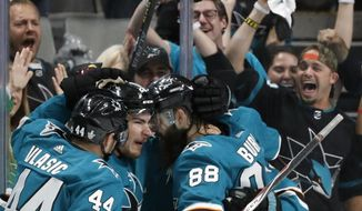 San Jose Sharks' Marc-Edouard Vlasic (44), Timo Meier (28) and Brent Burns (88) celebrate a goal by Meier against the St. Louis Blues in the second period in Game 1 of the NHL hockey Stanley Cup Western Conference finals in San Jose, Calif., Saturday, May 11, 2019. (AP Photo/Josie Lepe)