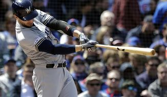 Milwaukee Brewers' Ryan Braun hits a solo home run against the Chicago Cubs during the fourth inning of a baseball game Friday, May 10, 2019, in Chicago. (AP Photo/Nam Y. Huh)