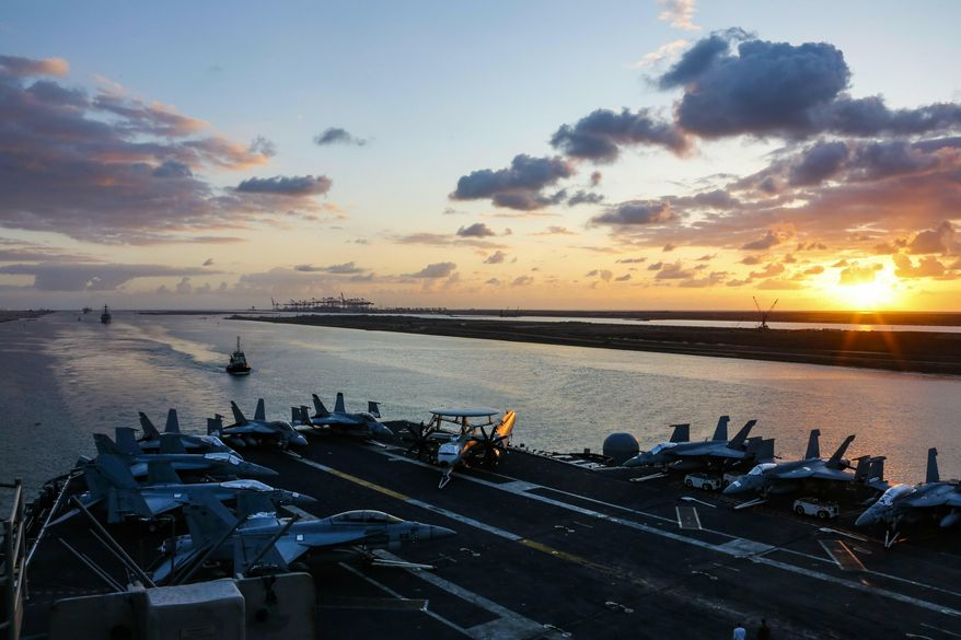 In this Thursday, May 9, 2019, file photo released by the U.S. Navy, the Nimitz-class aircraft carrier USS Abraham Lincoln transits the Suez Canal in Egypt. The aircraft carrier and its strike group are deploying to the Persian Gulf on orders from the White House to respond to an unspecified threat from Iran. (Mass Communication Specialist Seaman Dan Snow, U.S. Navy via AP)