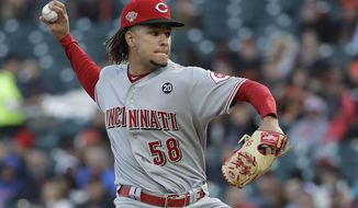 Cincinnati Reds pitcher Luis Castillo throws to a San Francisco Giants batter during the first inning of a baseball game in San Francisco, Friday, May 10, 2019. (AP Photo/Jeff Chiu)