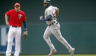 Detroit Tigers' Ronny Rodriguez rounds the bases after hitting a solo home run off Minnesota Twins pitcher Michael Pineda in the fourth inning of a baseball game Saturday, May 11, 2019, in Minneapolis. Rodriguez also homered in the second inning. (AP Photo/Jim Mone)