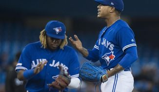 Toronto Blue Jays starting pitcher Marcus Stroman, right, reacts after being relieved during the seventh of a baseball game against the Chicago White Sox in Toronto on Saturday, May 11, 2019. (Nathan Denette/The Canadian Press via AP)