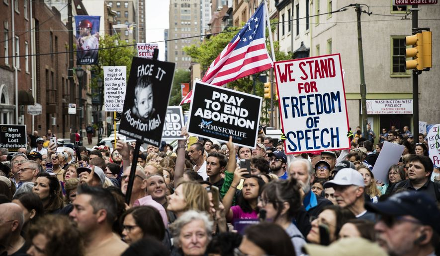 Anti-abortion protesters rally near a Planned Parenthood clinic in Philadelphia, Friday, May 10, 2019. The demonstration was spurred by the actions of a Democratic state lawmaker who recorded himself berating an anti-abortion demonstrator at length outside the clinic. (AP Photo/Matt Rourke)