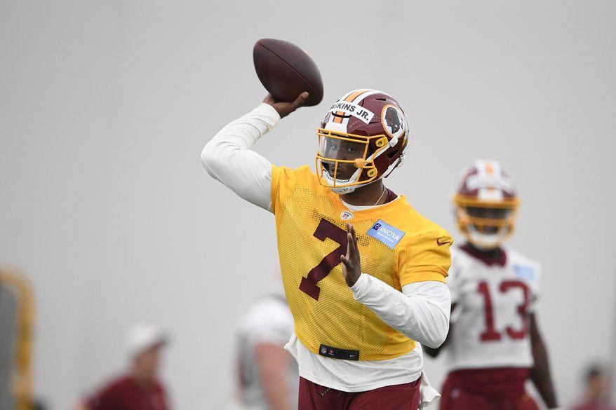 Washington Redskins quarterback Dwayne Haskins Jr. (7) throws a pass during an NFL football rookie camp, Saturday, May 11, 2019, in Ashburn, Va. (AP Photo/Nick Wass) ** FILE **