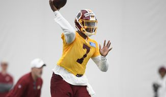 Washington Redskins quarterback Dwayne Haskins Jr. (7) throws a pass during an NFL football rookie camp, Saturday, May 11, 2019, in Ashburn, Va. (AP Photo/Nick Wass) ** FILE **