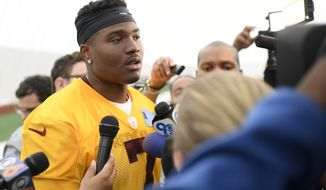 Washington Redskins quarterback Dwayne Haskins Jr. (7) talks to the media after an NFL football rookie camp practice, Saturday, May 11, 2019, in Ashburn, Va. (AP Photo/Nick Wass)
