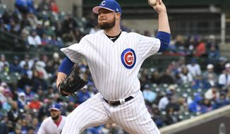 Chicago Cubs starting pitcher Jon Lester (34) throws the ball against the Milwaukee Brewers during the first inning of a baseball game, Sunday, May, 12, 2019, in Chicago. (AP Photo/David Banks)