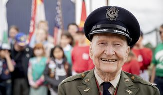 """Retired Col. Gail Halvorsen attends a ceremony to dedicate the baseball and softball field of the Berlin Braves baseball team in 'Gail Halvorsen Park' in Berlin , Saturday, May 11, 2019. Halvorsen is known as the """"Candy Bomber,"""" """"Chocolate Pilot,"""" and """"Uncle Wiggly Wings,"""" for the small candy-laden parachutes he dropped from his aircraft to children during the Berlin Airlift of 1948-1949. (Christoph Soeder/dpa via AP)"""