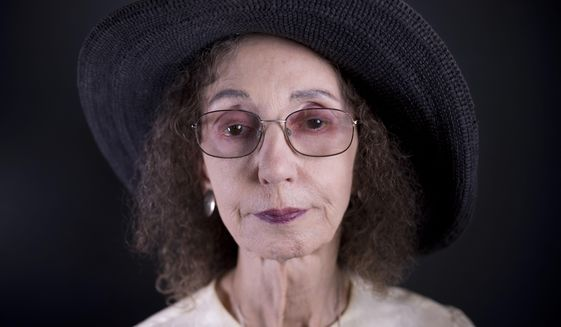 American author Joyce Carol Oates poses for a photo in Jerusalem, Sunday, May 12, 2019. Oates says her family's denial of its Jewish roots haunted her for decades and has shaped her into the famously prolific writer she is today. Oates, who is making her first-ever trip to Israel to receive the prestigious Jerusalem Prize, said that her Jewish grandmother fled persecution in her native Germany to rural upstate New York in the late 19th century. (AP Photo/Oded Balilty)