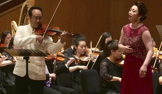 South Korean Violinist Won Hyung Joon and his North Korean soprano partner, Kim Song Mi perform at the Shanghai Oriental Arts Center in Shanghai on Sunday, May 12, 2019. Won, a South Korean, performed together with Kim, a North Korean, in a rare joint performance they hope would help bring the divided Koreas closer together via music. Their performance comes three days after North Korea fired two suspected short-range missiles in the second such weapons test in five days.(AP Photo/Dake Kang)