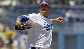 Los Angeles Dodgers starting pitcher Hyun-Jin Ryu throws to the Washington Nationals during the first inning of a baseball game Sunday, May 12, 2019, in Los Angeles. (AP Photo/Marcio Jose Sanchez)