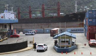 A view from the top of a two story building in Fagatogo village overlooking the Port of Pago Pago, as the North Korean cargo ship, Wise Honest, docks at the main docking section of Pago Pago Harbor, Saturday, May 11, 2019, in Pago Pago, American Samoa. The North Korean cargo ship was seized by the U.S. because of suspicion it was used to violate international sanctions. It arrived Saturday at the capital of this American territory. (AP Photo/Fili Sagapolutele)