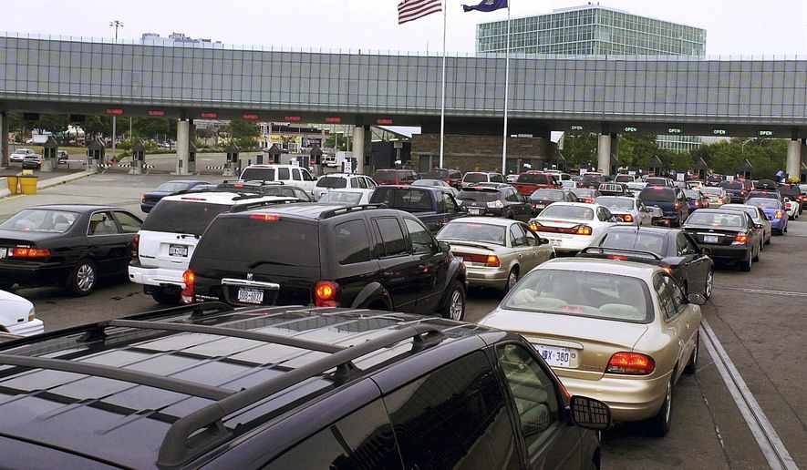 In this Aug. 4, 2005 file photo, traffic traveling from Niagara Falls, Ontario, Canada, lines up on the Rainbow Bridge to enter the United States through a border checkpoint at Niagara Falls, N.Y. (AP Photo/Don Heupel, File)