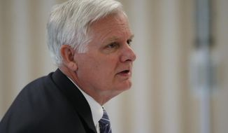 FILE - In this Thursday, May 9, 2019, file photo, University of Oklahoma President James L. Gallogly is pictured before a Board of Regents meeting in Norman, Okla. Gallogly, a former energy industry executive who came out of retirement to succeed David Boren as the university's president, said in a statement released Sunday, May 12, that he has advised the university's regents of his plans to retire once they have a transition plan in place. He took on the position last year. (AP Photo/Sue Ogrocki, File)