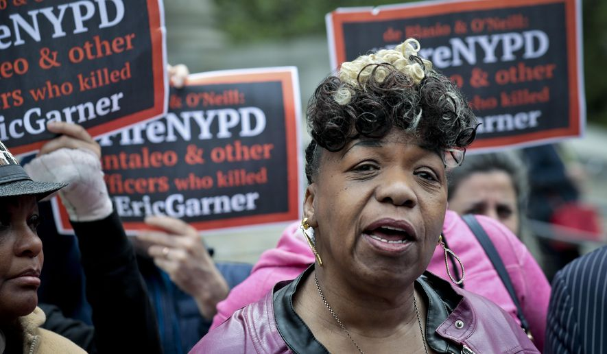 In this Thursday May 9, 2019 photo, Gwen Carr, left, mother of Eric Garner- an unarmed black man who died as he was being subdued in a chokehold by police officer Daniel Pantaleo nearly five years ago, speak during a press conference after leaving court in New York. A judge cleared the way for a police disciplinary trial to begin next week for Pantaleo in the death of Garner, after rejecting his claim that a police watchdog agency didn't have jurisdiction to prosecute the case. (AP Photo/Bebeto Matthews)