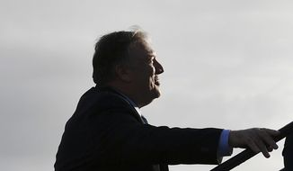 Secretary of State Mike Pompeo boards a plane before departing from London Stansted Airport, north of London, Monday, May 9, 2019.  Pompeo has canceled a visit to Greenland to return to Washington amid an escalation of tensions with Iran. (Mandel Ngan/Pool photo via AP)