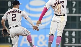 Houston Astros' Alex Bregman, left, and George Springer, right, celebrates the team's win over the Texas Rangers in a baseball game, Sunday, May 12, 2019, in Houston. (AP Photo/Eric Christian Smith)