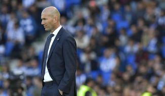 Real Madrid's head manager Zinedine Zidane stands on the touchline during the Spanish La Liga soccer match between Real Sociedad and Real Madrid, at Anoeta stadium, in San Sebastian, northern Spain, Sunday, May 12, 2019. (AP Photo/Alvaro Barrientos)