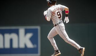 Detroit Tigers' Nicholas Castellanos runs the bases on a two-run home run off Minnesota Twins pitcher Martin Perez in the first inning of a baseball game Sunday, May 12, 2019, in Minneapolis. (AP Photo/Jim Mone)