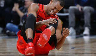 Portland Trail Blazers guard Rodney Hood reacts after being injured in the second half of Game 7 of an NBA basketball second-round playoff series against the Denver Nuggets Sunday, May 12, 2019, in Denver. (AP Photo/John Leyba)