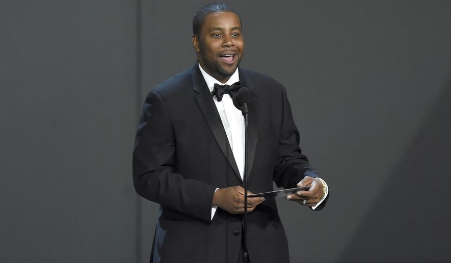 In this Sept. 17, 2018, photo Kenan Thompson presents the award for outstanding drama series at the 70th Primetime Emmy Awards at the Microsoft Theater in Los Angeles. (Photo by Chris Pizzello/Invision/AP) **FILE**