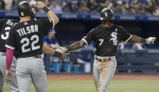Chicago White Sox Tim Anderson gestures as he crosses home plate after hitting a three run home run against the Toronto Blue Jays in the fourth inning of their American League  baseball game in Toronto Sunday, May 12, 2019. (Fred Thornhill/The Canadian Press via AP)