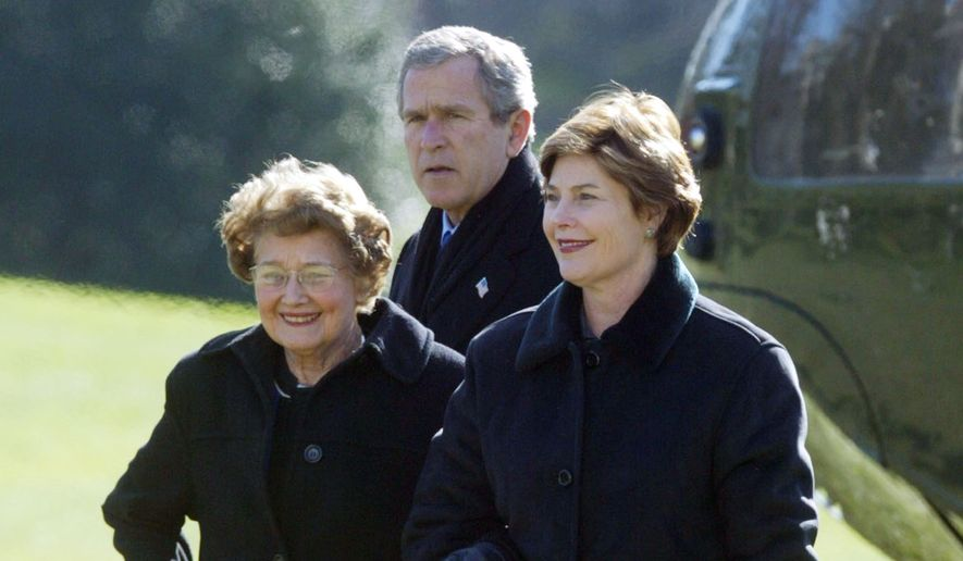 First lady Laura Bush walks with her mother Jenna Welch while President Bush looks on after arriving  at the White House following their weekend at Camp David Sunday, Dec. 15, 2002. (AP Photo/Rick Bowmer)