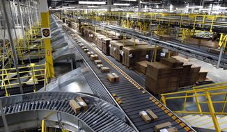In this Aug. 3, 2017, file photo, packages ride on a conveyor system at an Amazon fulfillment center in Baltimore. Amazon, which is racing to deliver packages faster, is turning to its employees with a proposition: Quit your job and well help you start a business delivering Amazon package. The offer, announced Monday, May 13, 2019, comes as Amazon seeks to speed up its shipping time from two days to one for its Prime members. (AP Photo/Patrick Semansky, File)