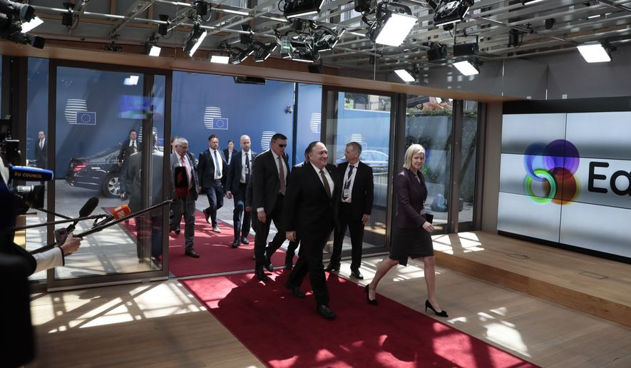 U.S. Secretary of State Mike Pompeo, center, arrives for a meeting with European foreign ministers at the Europa building in Brussels, Monday, May 13, 2019. The EU backers of the Iran nuclear deal meet with U.S. Secretary of State Mike Pompeo to discuss ways to keep the pact afloat. (AP Photo/Virginia Mayo)