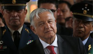 In this April 29, 2019, file photo, Mexican President Andrés Manuel López Obrador attends a ceremony at the Military Airbase Number 1 in Santa Lucia, on the outskirts of Mexico City. (AP Photo/Marco Ugarte, File)