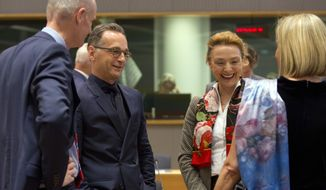 German Foreign Minister Heiko Maas, second left, speaks with European Union foreign policy chief Federica Mogherini, right, during a round table meeting of EU foreign ministers and Eastern Partnership nations at the Europa building, Monday, May 13, 2019. Dutch Foreign Minister Stef Blok is at left and Croatian Foreign Minister Marija Pejcinovic Buric is at second right. (AP Photo/Virginia Mayo)