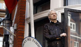 FILE - In this Friday, May 19, 2017 file photo, WikiLeaks founder Julian Assange looks out from the balcony while claiming political asylum at the Ecuadorian embassy in London. Swedish prosecutors are to reopen rape case against WikiLeaks founder Julian Assange, a month after he was removed from the Ecuadorian Embassy in London. (AP Photo/Frank Augstein, File)
