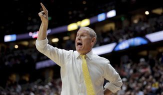 FILE - In this March 28, 2019 file photo, Michigan coach John Beilein shouts during the first half of the team's NCAA men's college basketball tournament West Region semifinal against Texas Tech in Anaheim, Calif. Cleveland has signed Beilein to a five-year contract, three people familiar with the decision told The Associated Press on Monday, May 13. The deal came together quickly in the past 24 hours and was finalized Sunday after the Cavs had spent the weekend in Denver interviewing several NBA assistants. The people spoke to The AP condition of anonymity because the team had not announced the hire.  (AP Photo/Jae C. Hong, File)