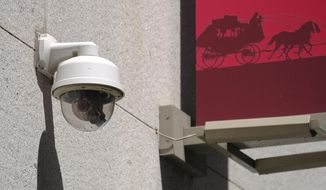 This photo taken Tuesday, May 7, 2019, shows a security camera in the Financial District of San Francisco. A civilian board that oversees Detroit police has approved the use of facial recognition technology to investigate crimes. (AP Photo/Eric Risberg) ** FILE **