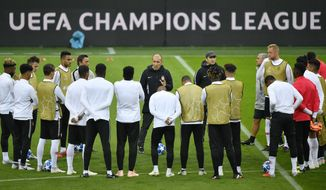 FILE - In this Oct. 2, 2018, photo Monaco's head coach Leonardo Jardim, center, talks to his team during a training session on the eve of the Champions League group A soccer match between Borussia Dortmund and AS Monaco in Dortmund, Germany. A Champions League semifinalist in 2017, Monaco is in danger of dropping to the French league's second division. Following this weekend's 1-0 loss at Nimes, Monaco stands in 17th place in the standings with two matches left to play, above the bottom three only on goal difference. (AP Photo/Martin Meissner)