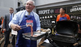 U.S. Secretary of Agriculture Sonny Perdue prepares to barbecue U.S. beef in Tokyo Monday, May 13, 2019. Perdue barbecued American beef in Tokyo to highlight his message: Japan must treat the U.S. fairly as a top customer for Japanese products. (AP Photo/Yuri Kageyama)