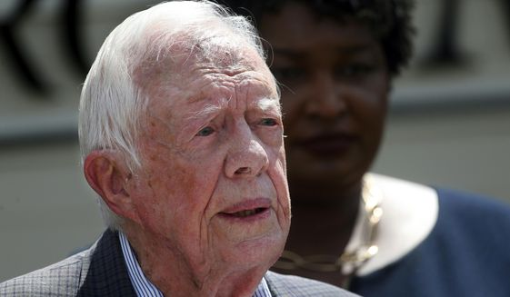 In this Sept. 18, 2018, photo, former President Jimmy Carter speaks during a news conference, in Plains, Ga. A spokeswoman says former U.S. President Jimmy Carter says he has broken his hip. She said that Carter underwent surgery at a medical center in Americus, Ga. (AP Photo/John Bazemore) **FILE**