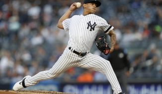 New York Yankees starting pitcher Jonathan Loaisiga delivers during the third inning of a baseball game against the Seattle Mariners, Wednesday, May 8, 2019, in New York. (AP Photo/Kathy Willens)