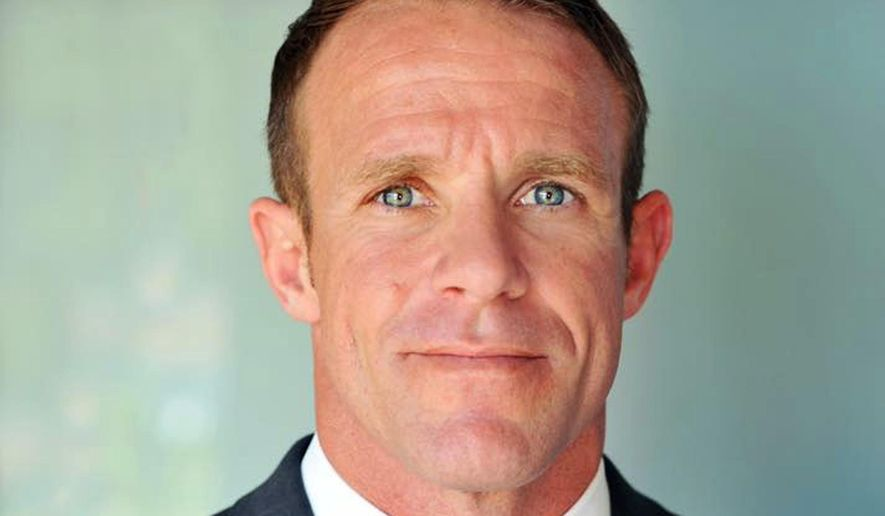 This 2018 file photo provided by Andrea Gallagher shows her husband, Navy SEAL Edward Gallagher, who has been charged with murder in the 2017 death of an Iraqi war prisoner. Lawyers on Gallagher's defense team told The Associated Press that emails they and a reporter received from military prosecutors in the case contained tracking software. (Andrea Gallagher via AP, File)