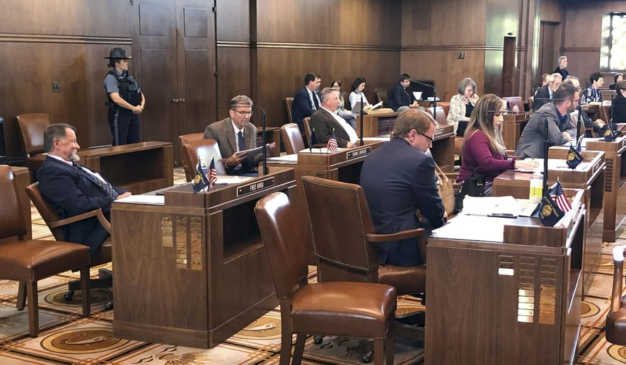 In this file photo from May 2019, Republican state senators are shown in the state capital of Salem, after ending a standoff with state Democrats. The state Senate GOP subsequently walked out again on June 20, 2019 to protest a cap-and-trade bill they consider fundamentally harmful to the state's economy. On Friday, June 28, the Republicans announced they would be returning to the capitol, with Senate Democrats having lost support within their ranks to pass the controversial bill, which had seen various protests by the state's rural citizens subsequent to the GOP walkout.  (AP Photo/Andrew Selsky) **FILE**
