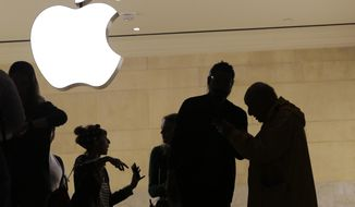 In this May 31, 2018, file photo customers enter the Apple store in New York. The Supreme Court is allowing consumers to pursue an antitrust lawsuit that claims Apple has unfairly monopolized the market for the sale of iPhone apps. (AP Photo/Mark Lennihan, File)
